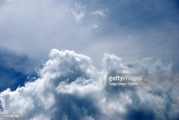 low angle view of clouds in sky - tolga erbay stock photos and pictures