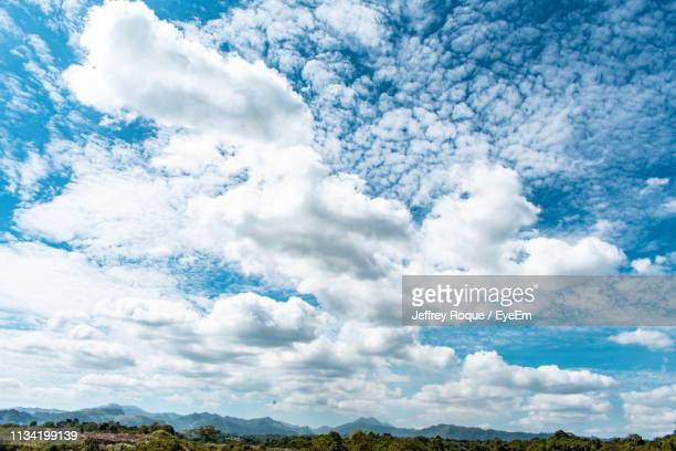 low angle view of clouds in sky - jeffrey roque stock photos and pictures