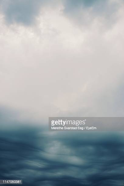 low angle view of clouds in sky - fog stock pictures, royalty-free photos & images