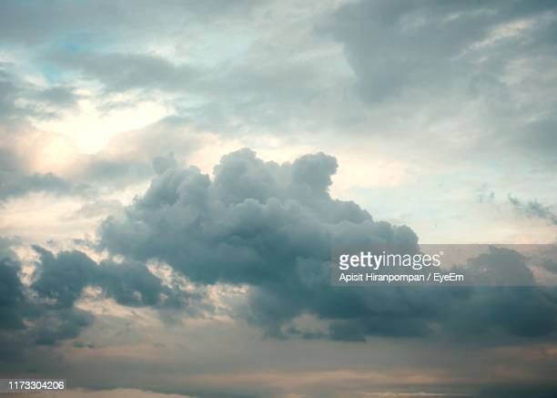 low angle view of clouds in sky - moody sky stock pictures, royalty-free photos & images