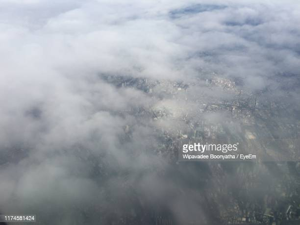 low angle view of clouds in sky - wipavadee stock photos and pictures