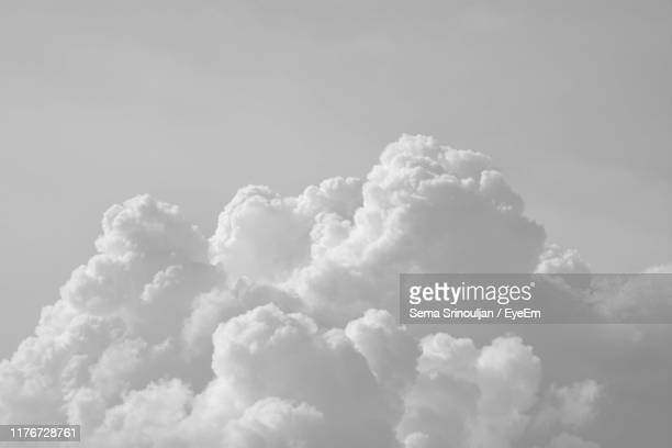 low angle view of clouds in sky - black and white nature stock pictures, royalty-free photos & images