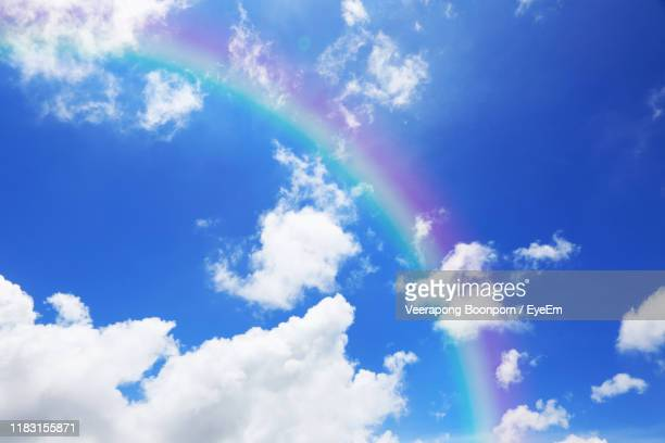 low angle view of clouds in sky - rainbow sky stock pictures, royalty-free photos & images