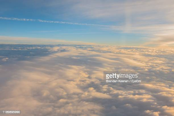low angle view of clouds in sky - scenics stock pictures, royalty-free photos & images
