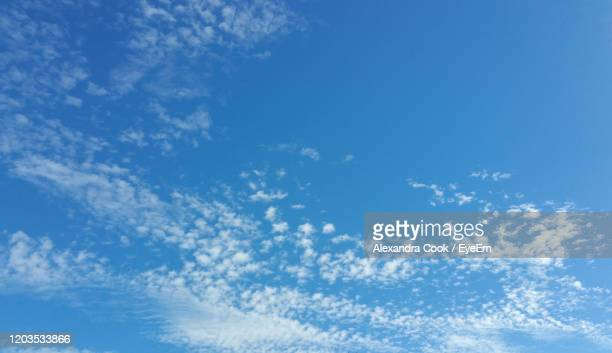 low angle view of clouds in sky - alexandra valencia stock-fotos und bilder