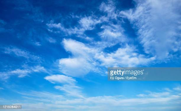 low angle view of clouds in sky - 青 ストックフォトと画像