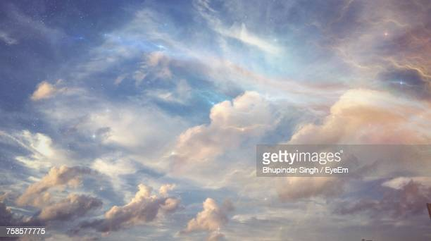 low angle view of clouds in sky - elysium stock photos and pictures
