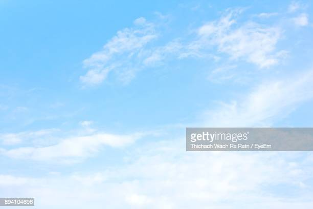 low angle view of clouds in sky - blue sky stock photos and pictures