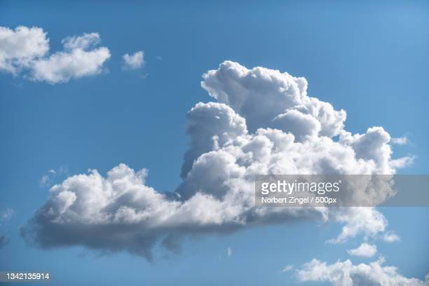 low angle view of clouds in sky,gelting,germany - norbert zingel stock-fotos und bilder