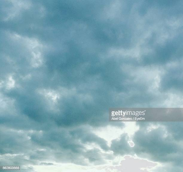 low angle view of cloudy sky - cloudy stock photos and pictures