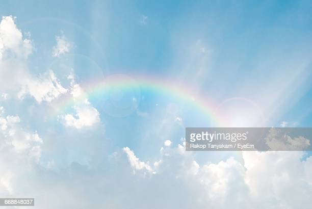 low angle view of cloudy sky - rainbow stock pictures, royalty-free photos & images