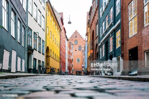 low angle view of cobblestone street in copenhagen, denmark - alles hinter sich lassen stock-fotos und bilder