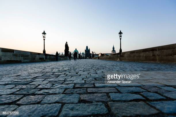 Low angle view of cobblestones on Charles Bridge, Prague, Czech Republic