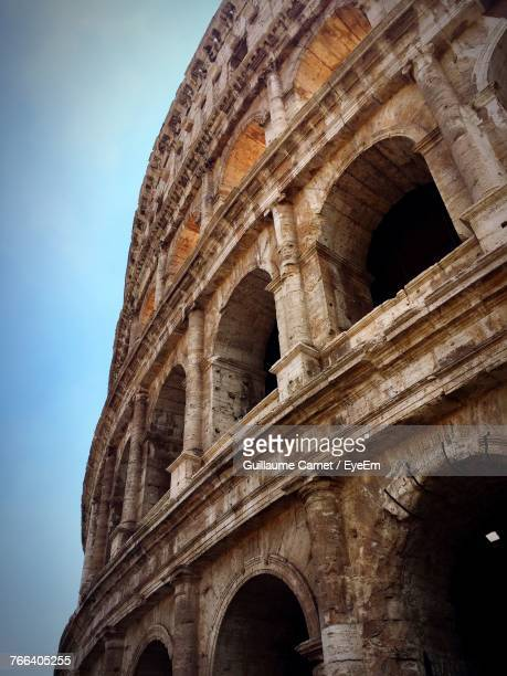 low angle view of coliseum - carnet stock photos and pictures