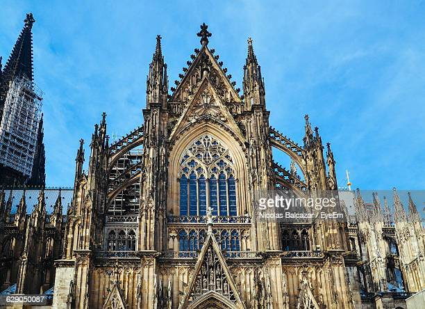 low angle view of cologne cathedral against sky - cologne cathedral stock photos and pictures