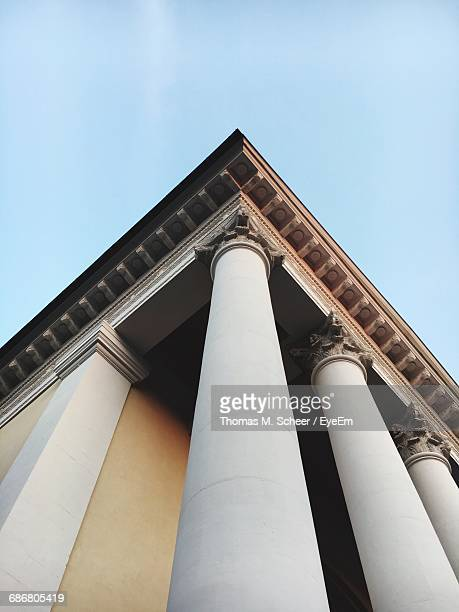 Low Angle View Of Colonnade Against Sky