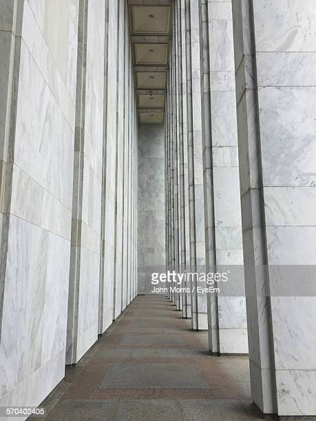 low angle view of colonnade in building - colonnade stock pictures, royalty-free photos & images