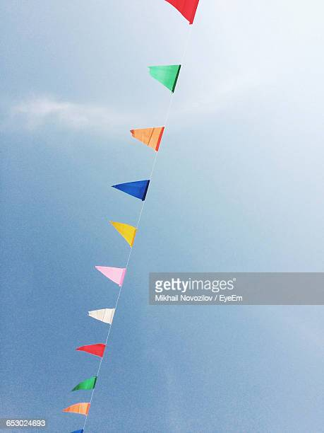 Low Angle View Of Colorful Bunting Flags Against Sky