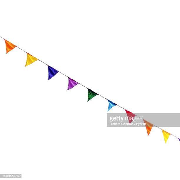 low angle view of colorful buntings against clear sky - bunting stock pictures, royalty-free photos & images