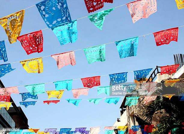 Low Angle View Of Colorful Decoration Hanging Against Clear Sky