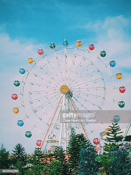 Low Angle View Of Colorful Ferris Wheel Against Sky