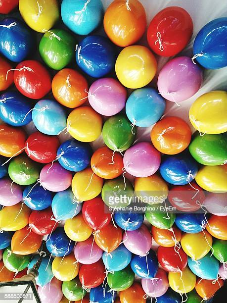 Low Angle View Of Colorful Helium Balloons Decorated On Ceiling