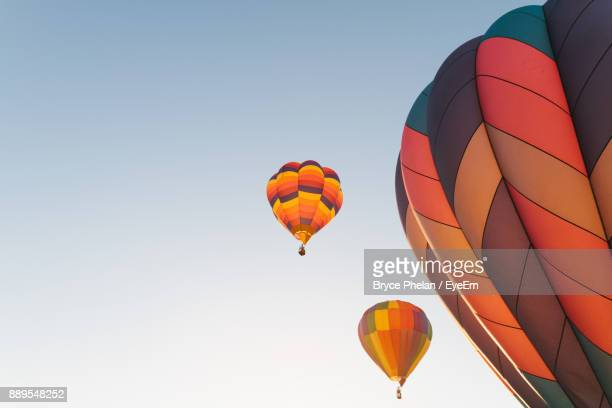 Low Angle View Of Colorful Hot Air Balloons Against Clear Sky