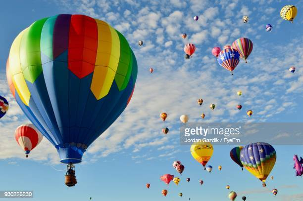 low angle view of colorful hot air balloons against sky - balloon fiesta stock pictures, royalty-free photos & images