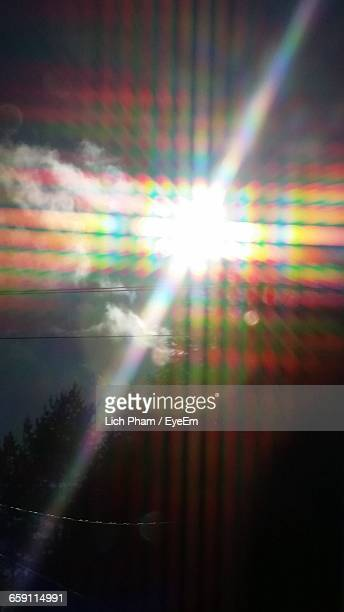 Low Angle View Of Colorful Lens Flare Against Sky