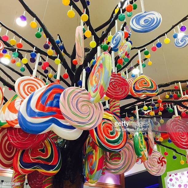Low Angle View Of Colorful Lollipops For Sale In Candy Store