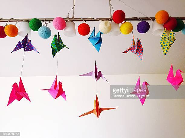 Low Angle View Of Colorful Origami Cranes Hanging From Ceiling