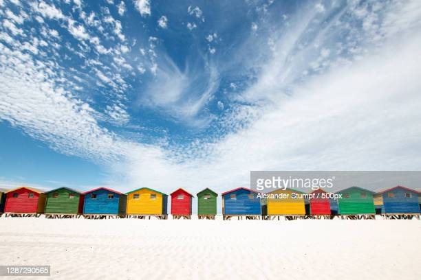 low angle view of colorful parasols at beach against sky,muizenberg,south africa - south africa stock pictures, royalty-free photos & images