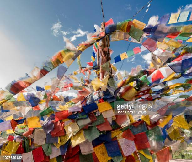 Low Angle View Of Colorful Prayer Flags Hanging Against Sky