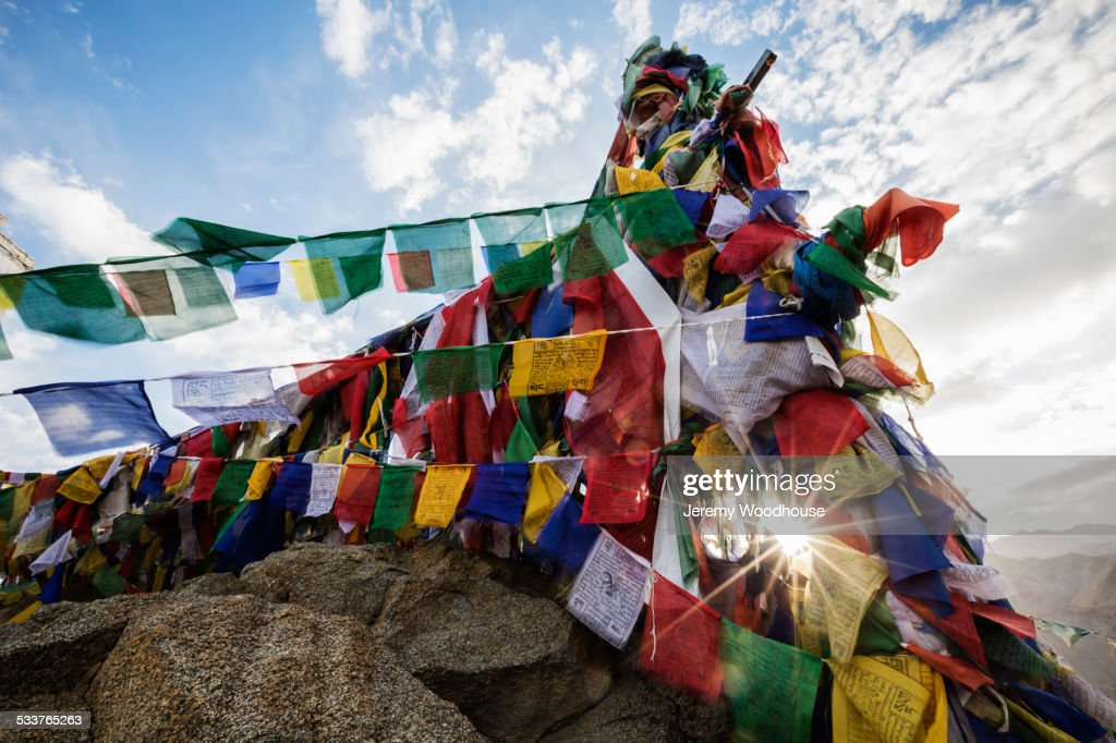 Low angle view of colorful prayer flags on monastery wall : Foto stock