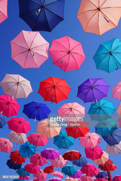 Low Angle View Of Colorful Umbrellas Against Clear Blue Sky