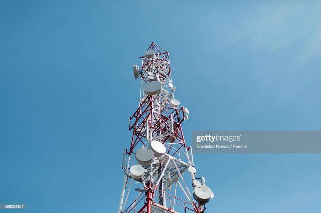 Low Angle View Of Communications Tower Against Blue Sky : Stock Photo