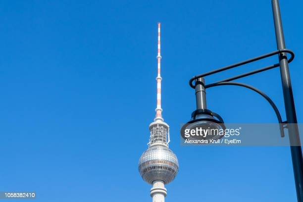 Low Angle View Of Communications Tower Against Clear Blue Sky During Sunny Day
