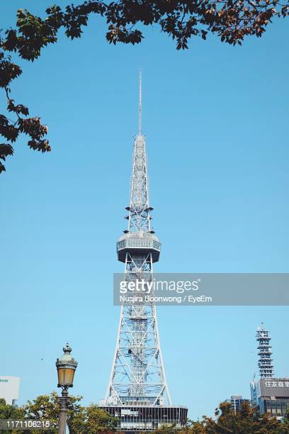 low angle view of communications tower against clear blue sky - nagoya stock pictures, royalty-free photos & images