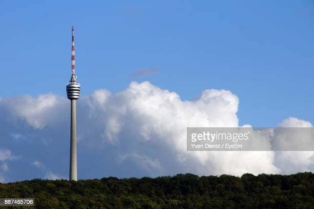 low angle view of communications tower against cloudy sky - stuttgart stock pictures, royalty-free photos & images