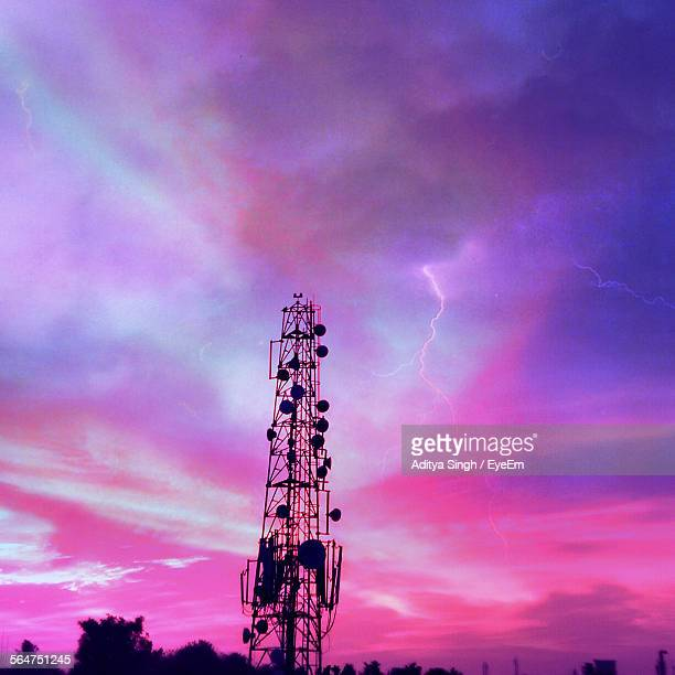 Low Angle View Of Communications Tower Against Dramatic Sky