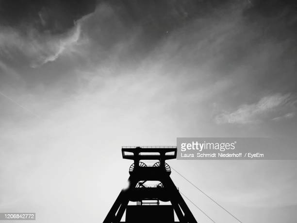 low angle view of communications tower against sky - laura schmidt foto e immagini stock