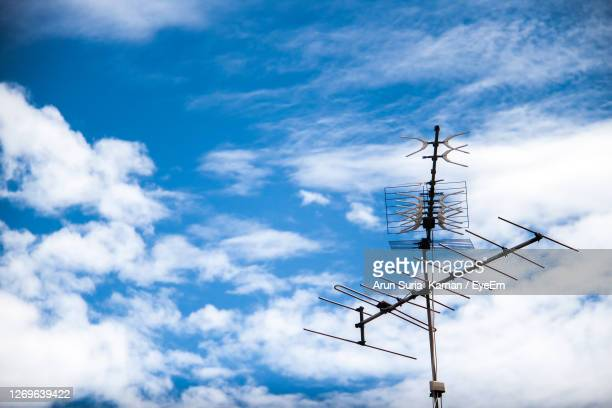 low angle view of communications tower against sky - blue angels stock pictures, royalty-free photos & images