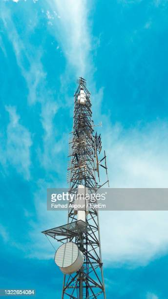low angle view of communications tower against sky - iran stock pictures, royalty-free photos & images