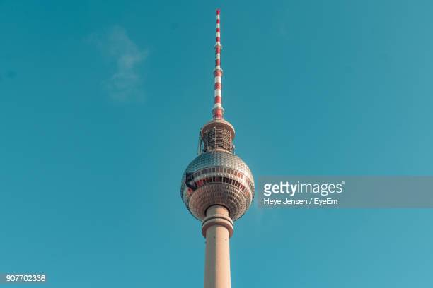 low angle view of communications tower against sky - television tower berlin stock pictures, royalty-free photos & images