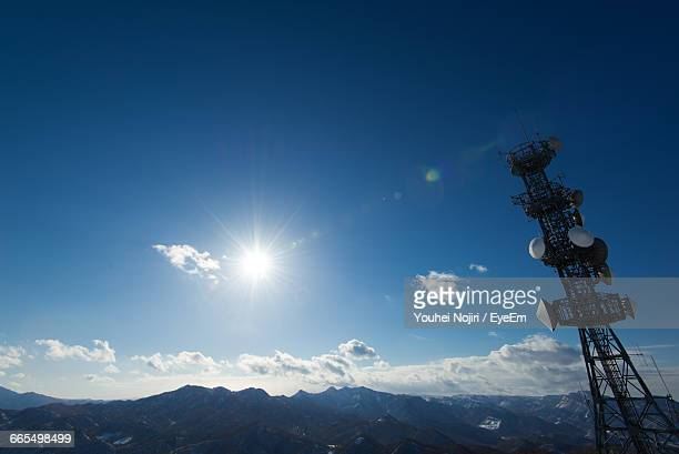 Low Angle View Of Communications Tower By Mountain Against Sky