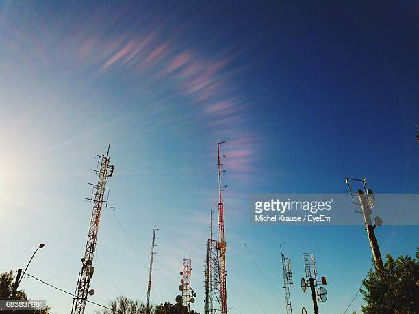 Low Angle View Of Communications Towers During Sunny Day