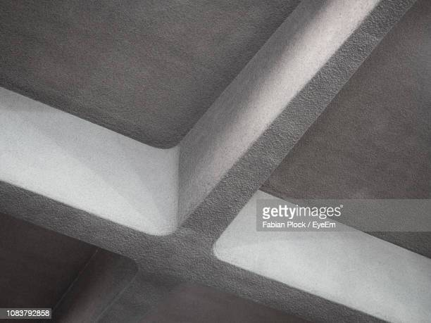 low angle view of concrete cross on ceiling - solid stock pictures, royalty-free photos & images