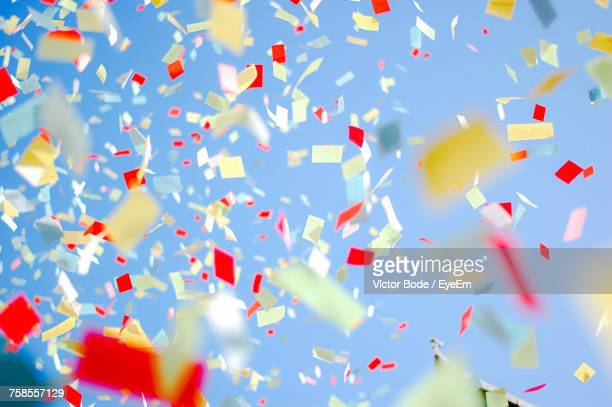 low angle view of confetti against clear sky - celebration stock pictures, royalty-free photos & images