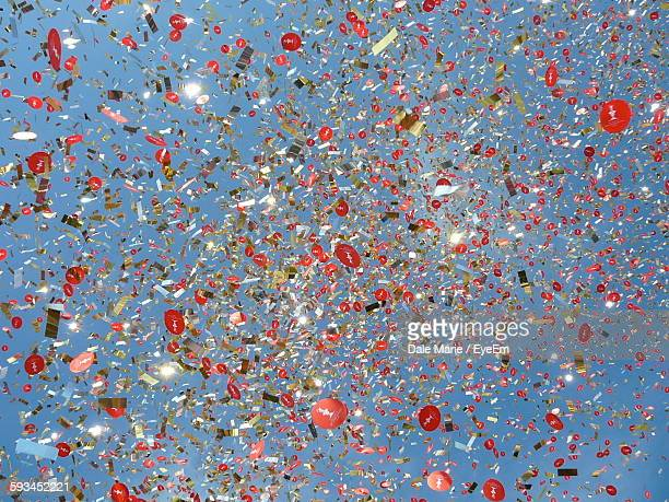 Low Angle View Of Confetti Against Sky