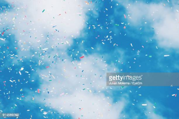 low angle view of confetti against sky - confetti stock pictures, royalty-free photos & images